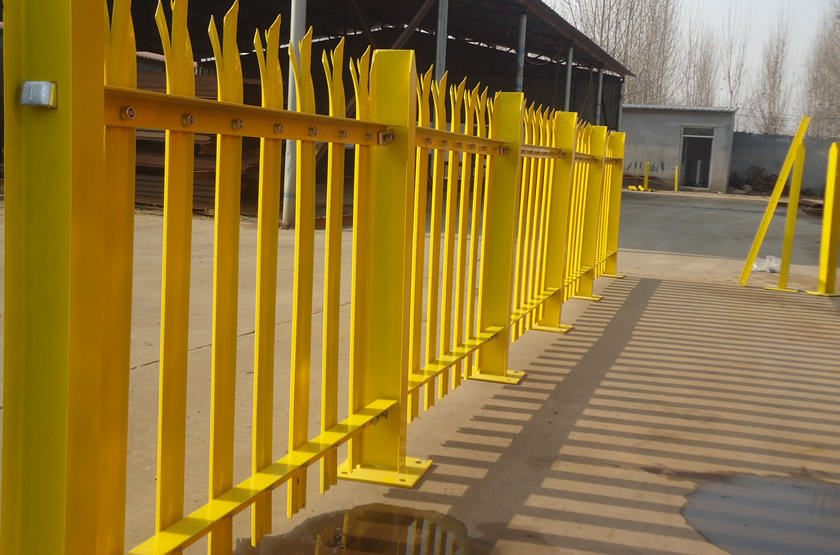 Heavy duty palisade W section fencing painted in yellow color installed in our factory.