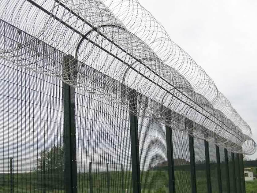 358 security fence with razor barbed wire is installed on the outdoor fields.