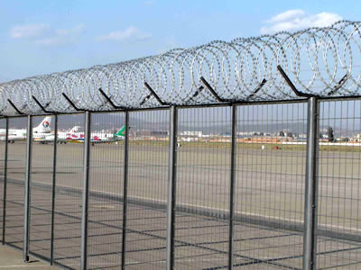 Galvanized welded wire mesh fence around the airport with razor barbed wire on the top.
