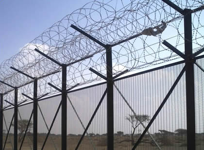Concertina wire mounted on 358 mesh fencing forms a high security fencing
