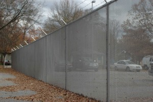 Grey mini mesh chain link fencing plus barbed wire on the top for parking fencing system.