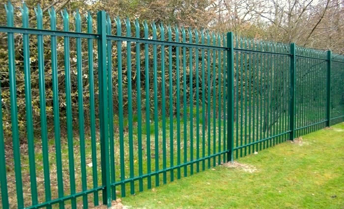 Green plastic coated palisade fencing used to protect farm